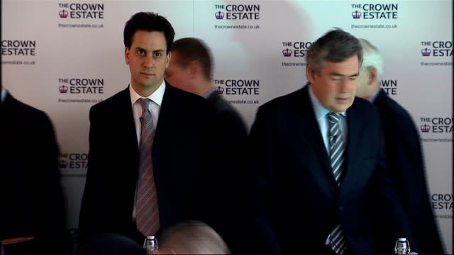 gordon brown announces programme to build more offshore wind farms; brown and others along to stage, standing for group photocall with miliband and... - co ordination stock videos & royalty-free footage