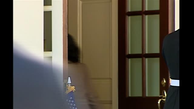 gordon brown arrival at white house; usa: washington: white house: ext gordon brown mp out of car and into white house with aides - gordon brown stock-videos und b-roll-filmmaterial