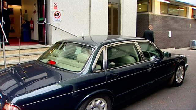 Gordon Brown arriving departing GMTV studios / arriving departing Millbank ENGLAND London GMTV studios INT Gordon Brown MP getting out of car then...
