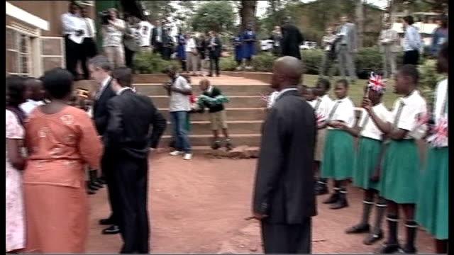 gordon brown defends defence budget; uganda: kampala: brown and douglas alexander mp meeting group of ugandan men and women as one women squeals and... - douglas alexander stock videos & royalty-free footage
