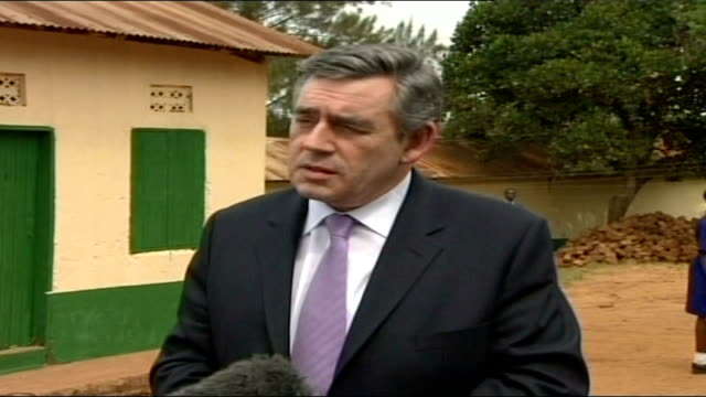 gordon brown defends defence budget; uganda: kampala: ext gordon brown mp interview sot - i've got nothing but praise for our armed forces / i... - kampala stock videos & royalty-free footage