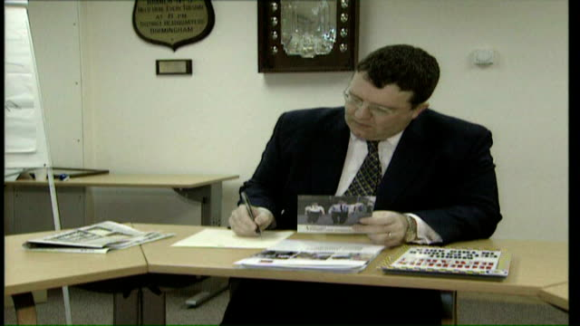gordon brown denies leadership conspiracy / tony blair visits israel tx tom watson mp working at desk split screen watson working at desk / gordon... - politician stock videos & royalty-free footage