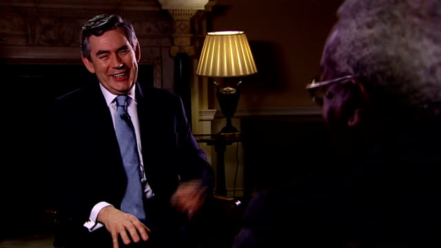 gordon brown discusses uk trading relationship interview with sir trevor mcdonald interview ends and brown and sir trevor chat about their families... - human relationship stock videos & royalty-free footage