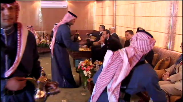 gordon brown gulf tour day 2 riyadh and doha brown listening to former student from sheffield university talk about a science park sot / brown being... - prince stock videos and b-roll footage