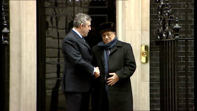 Gordon Brown handshake and photocall with Mahmoud Abbas ENGLAND London Westminster Downing Street EXT Car arriving / Gordon Brown greeting Mahmoud...