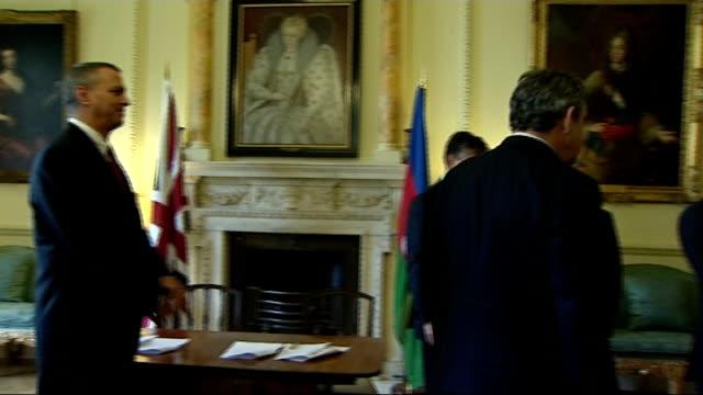 gordon brown handshake with president of azerbaijan; england: london: downing street: int gordon brown mp handshake photocall with ilham aliyev and... - plc stock videos & royalty-free footage