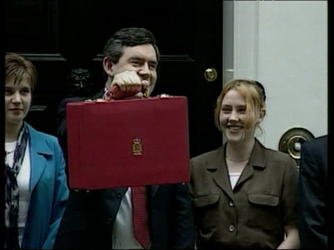 gordon brown holds up red briefcase alongside apprentices who made it to mark his first budget jul 97 - ゴードン ブラウン点の映像素材/bロール