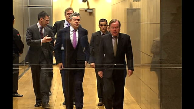 gordon brown in brussels for eu summit on financial crisis; belfium: brussells: int gordon brown mp along corridor to meeting and photocall of eu... - gordon brown stock-videos und b-roll-filmmaterial
