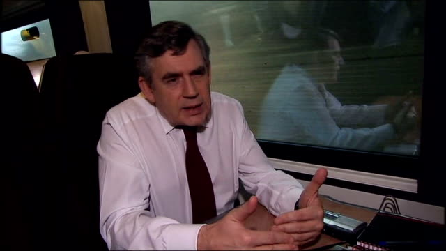 gordon brown interview on train en route to derby; england: int train gordon brown mp interview sot - doing everything we can to deal with global... - gordon brown stock-videos und b-roll-filmmaterial