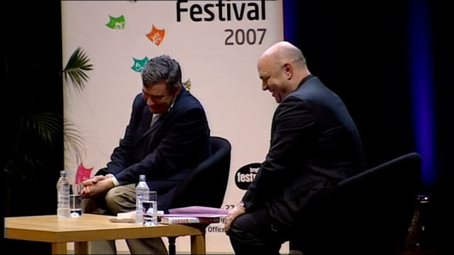 gordon brown interviewed by film director anthony minghella; anthony minghella speaking sot - introduces the talk / we've done this talk a couple of... - the english patient点の映像素材/bロール