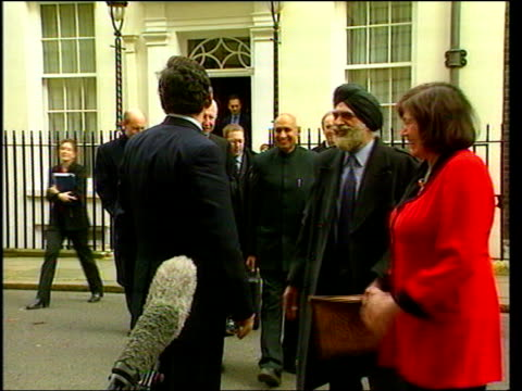 Gordon Brown ITN ENGLAND London Downing Street EXT Chancellor Gordon Brown MP with Clare Short MP and religious leaders towards from number 10 to...