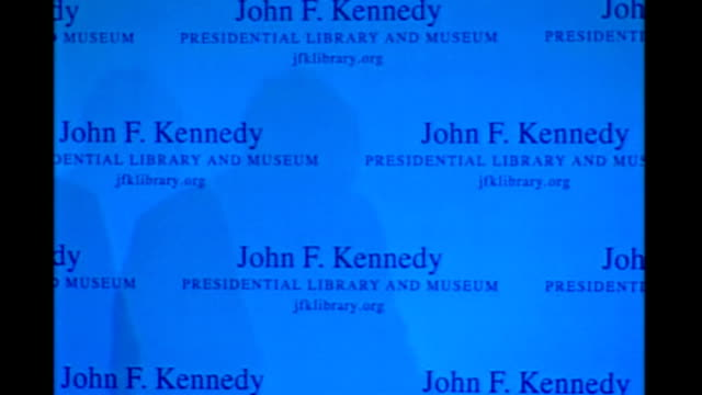 gordon brown keynote speech at kennedy library brown along on stage shaking hands with senator edward kennedy then along to podium / brown's shadow... - keynote speech stock videos and b-roll footage