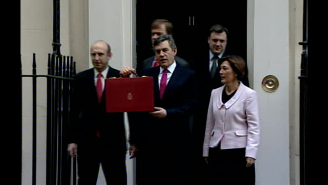 gordon brown launches labour party leadership campaign lib downing street ext brown mp holding red budget box posing outside number 11 with treasury... - number 11 stock videos and b-roll footage