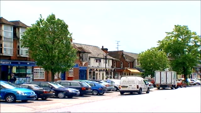 report from stevenage ext high street with cars parked narrow shopping street with more traditional shops - stevenage stock videos and b-roll footage