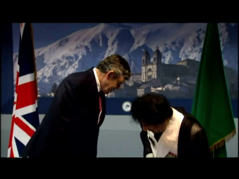 gordon brown meets colonel gaddafi for the firs time at the g8 summit in l'aqulia in italy - g8 stock-videos und b-roll-filmmaterial