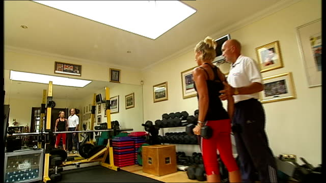 gordon brown optimistic on economic recovery; england: essex: basildon: int good shots of personal fitness trainer richard condon and client richard... - basildon stock videos & royalty-free footage