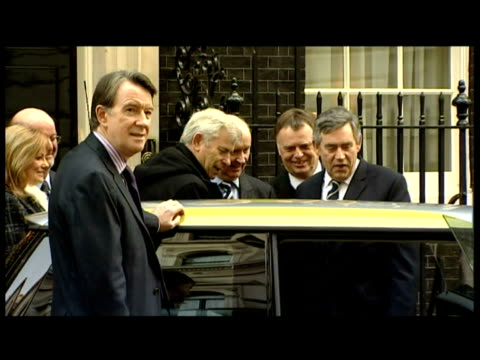 Gordon Brown Peter Mandelson other officials examine the new electric car the MiniE car at 10 Downing Street