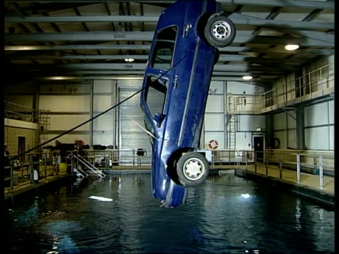 gordon brown plunges car into stunt pool at pinewood studios england buckinghamshire pinewood studios int gordon brown mp speaking to camera crew and... - underwater film camera stock videos & royalty-free footage