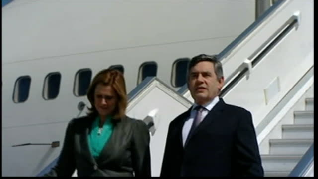 gordon brown presummit world tour reaches chile chile santiago ext gordon brown mp and sarah brown along down steps as getting off aeroplane then... - guard of honour stock videos and b-roll footage