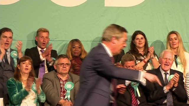 Gordon Brown questions the Brexit Party's system of funding ENGLAND London Hammersmith INT Nigel Farage MEP speech and sitting down to standing...