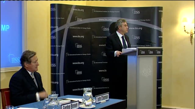 gordon brown speech on afghanistan; gordon brown sitting next to and chatting with bob ainsworth mp / cutaways of gordon brown at podium giving... - douglas hurd stock-videos und b-roll-filmmaterial