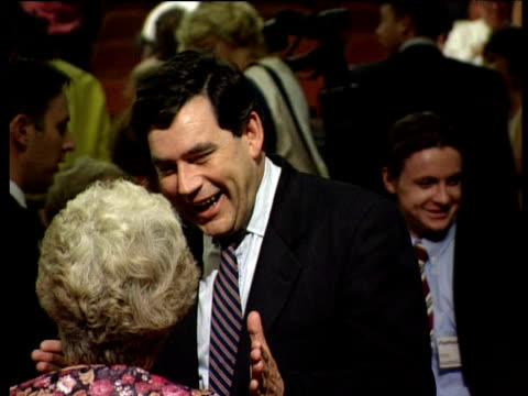 gordon brown talks happily to labour party member london 1994 - ゴードン ブラウン点の映像素材/bロール