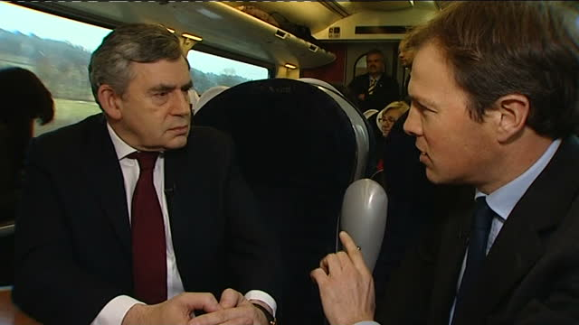 gordon brown tours recession hit britain; derby: ext gordon brown at railway station, shaking hands with train passengers back view train passenger... - individuality stock videos & royalty-free footage
