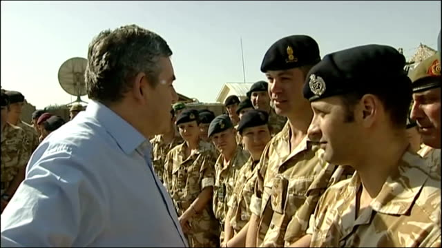 gordon brown visit british troops in afghanistan; afghanistan: helmand province: lashkar gah: int machine gunner at rear open door of british army... - surrounding wall点の映像素材/bロール
