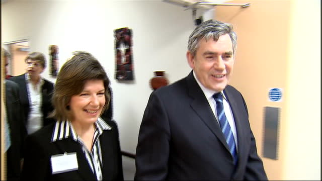 gordon brown visit to community resource centre in plaistow close up brown / elderly woman talking / cup of tea served to brown / woman showing brown... - notice board stock videos and b-roll footage