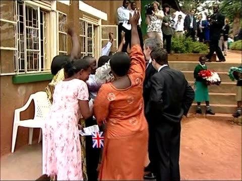 gordon brown visit to school in kampala; brown and douglas alexander mp stand speaking to local people as one woman makes high-pitch squeal and brown... - douglas alexander stock videos & royalty-free footage