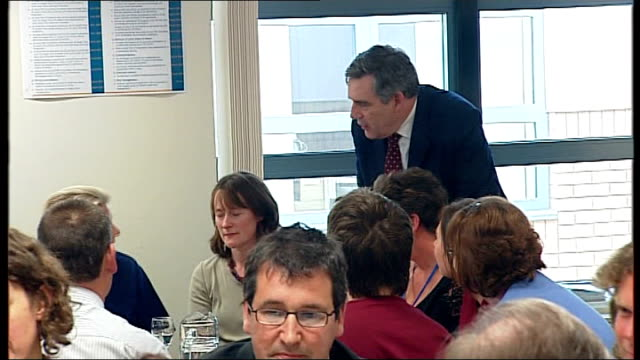 Gordon Brown visits Royal Devon and Exeter Hospital Ben Bradshaw MP seated chatting with hospital staff SOT / Brown along into room as introduced by...