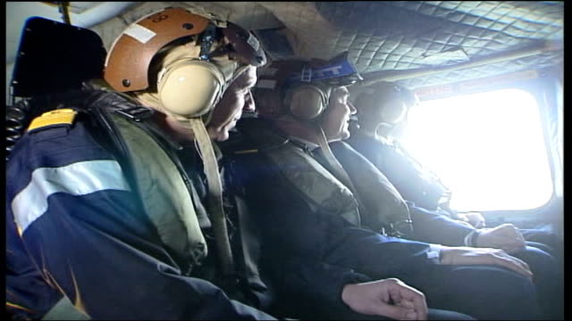 gordon brown visits royal navy warship england hampshire mid shot gordon brown mp sitting in helicopter en route to visit warship close mid shot... - lowering stock videos & royalty-free footage