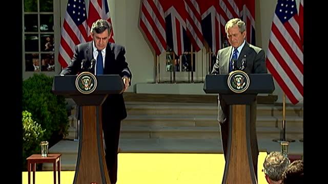 Washington D C White House Rose Garden EXT Gordon Brown MP atanding at press conference next to George W Bush Gordon Brown MP press conference SOT a...