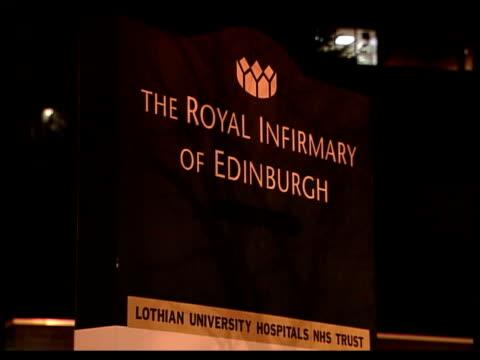 gordon brown's baby dies itn edinburgh edinburgh royal infirmary hospital building with lights on mss window with blinds drawn ms cms sign 'the royal... - 継父点の映像素材/bロール