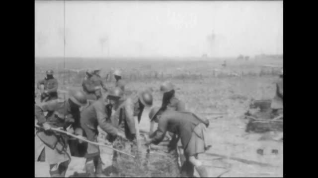Gordon Highlanders spread barbed wire barricades