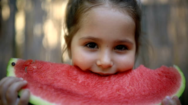 gorgeous and cute toddler eating a watermelon - juicy stock videos & royalty-free footage