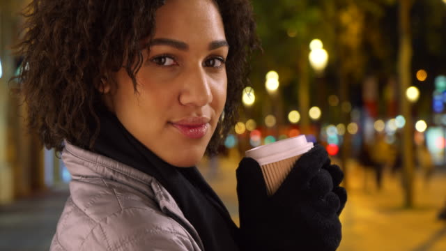 gorgeous black female holds coffee cup, smiling at camera on the champs-elysees - seeing paris: on the boulevards stock videos & royalty-free footage