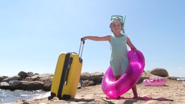 gorgeous child tourist in summer on the beach - inflatable stock videos & royalty-free footage