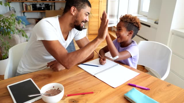 gorgeous daughter finishing homework with father in the morning - homework stock videos & royalty-free footage