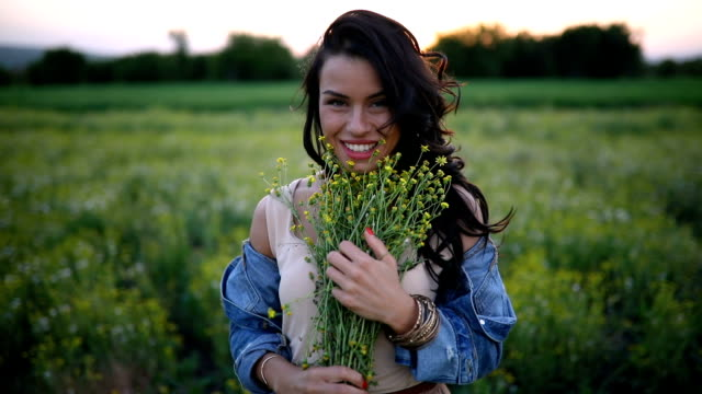 gorgeous girl with dandelions in denim jacket - denim jacket stock videos and b-roll footage