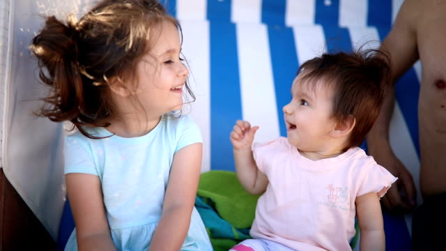 gorgeous little sisters smiling together - modern manhood stock videos & royalty-free footage