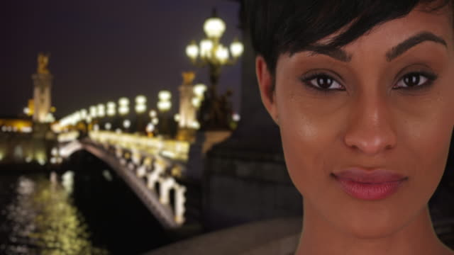 gorgeous mixed race woman gazes with passion at viewer near pont alexandre iii - pont alexandre iii stock videos & royalty-free footage