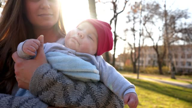 gorgeous mother and a cute sleeping baby - eyes closed stock videos & royalty-free footage
