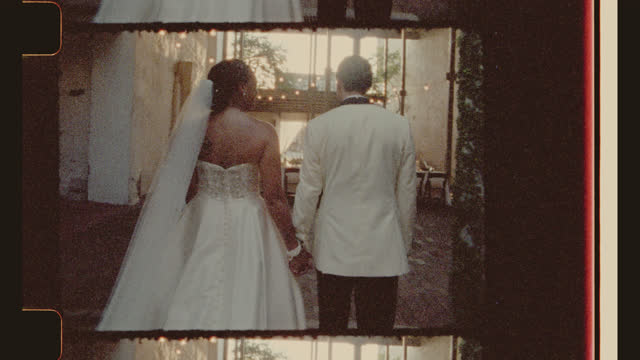 gorgeous newlyweds walk into the sun as they hold hands in marriage - eternity stock videos & royalty-free footage