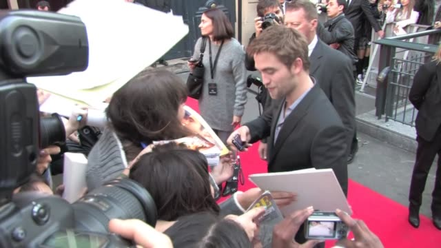 Gorgeous Robert Pattinson and Ashley Greene at a signing in Paris for the promotion of Twilight 4 Signing screaming fans pictures more signing more...
