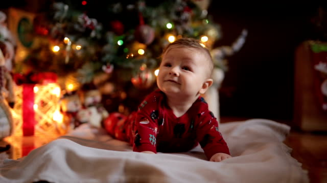 gorgeous smiling toddler boy in christmas pajamas - pyjamas stock videos & royalty-free footage