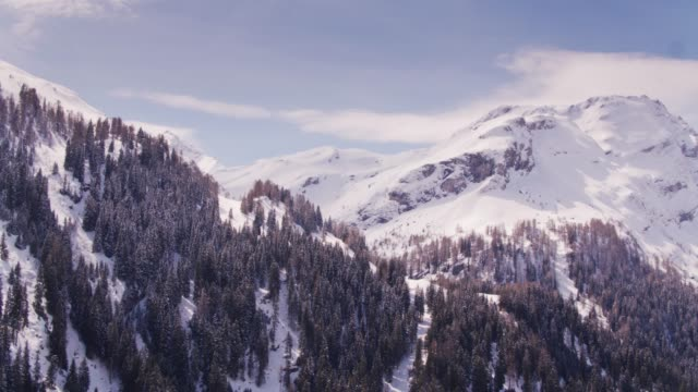 gorgeous snowy alpine landscape - drone shot - chalet stock videos & royalty-free footage