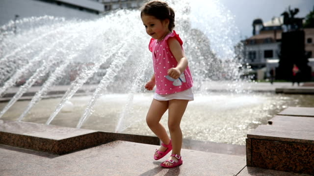 gorgeous toddler girl at a city fountain - children only stock videos & royalty-free footage