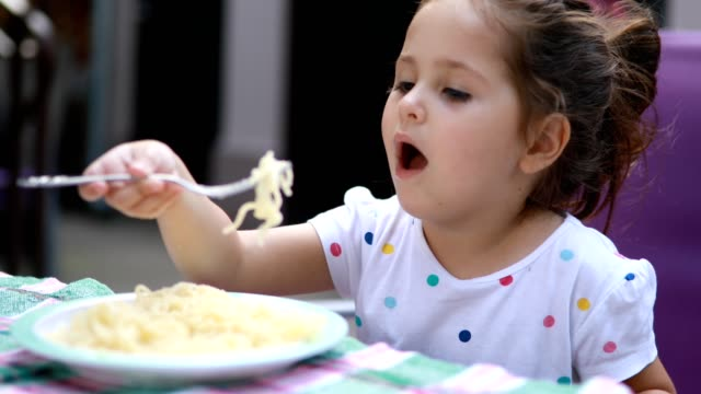 gorgeous toddler girl eating pasta - fork stock videos & royalty-free footage