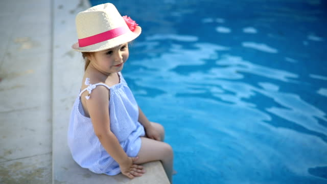 Gorgeous toddler having fun by the pool